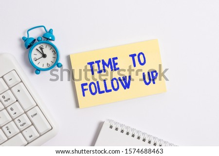 Conceptual hand writing showing Time To Follow Up. Business photo text Enquiry of the previous task or information Continuation Keyboard with empty note paper and pencil white background. #1574688463