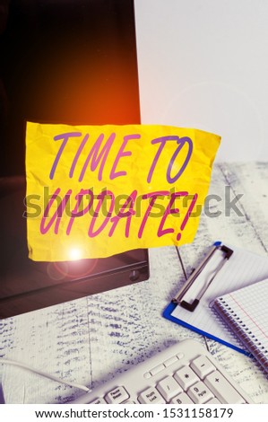 Conceptual hand writing showing Time To Update. Business photo showcasing act updating something someone or updated version program Note paper taped to black screen near keyboard stationary. #1531158179