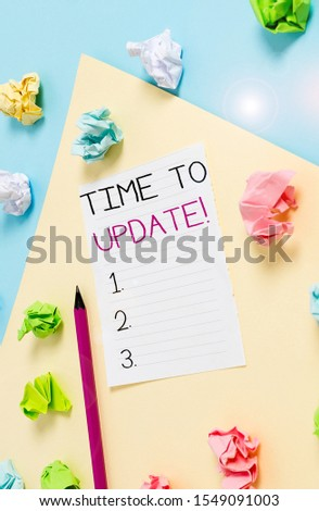 Conceptual hand writing showing Time To Update. Business photo showcasing act updating something someone or updated version program Colored crumpled paper empty reminder blue yellow clothespin. #1549091003