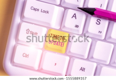 Conceptual hand writing showing Time To Update. Business photo showcasing act updating something someone or updated version program White pc keyboard with note paper above the white background. #1555889357