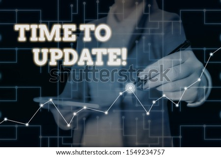 Conceptual hand writing showing Time To Update. Business photo text act updating something someone or updated version program Woman wear formal work suit present using smart latest device. #1549234757