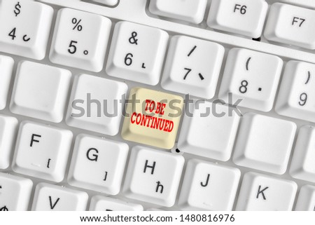 Conceptual hand writing showing To Be Continued. Business photo showcasing indicate that the story continues in the next episode White pc keyboard with note paper above the white background. #1480816976