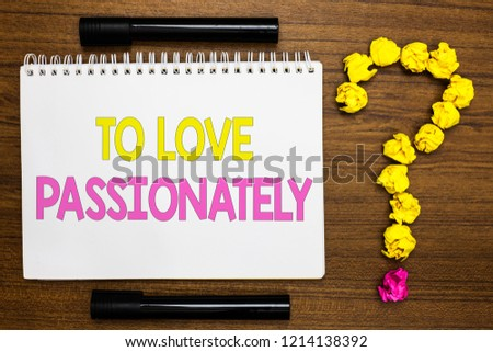 Conceptual hand writing showing To Love Passionately. Business photo showcasing Strong feeling for someone or something else Affection White page with bright color word black pen yellow paper lob. #1214138392