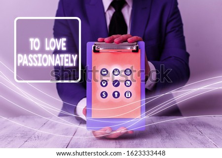 Conceptual hand writing showing To Love Passionately. Business photo showcasing Strong feeling for someone or something else Affection.