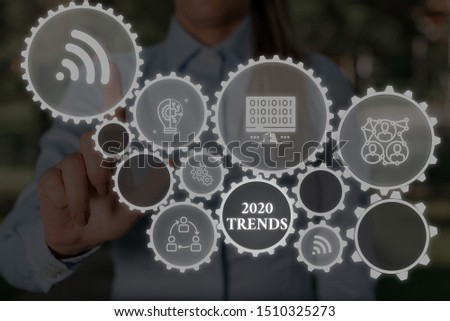 Conceptual hand writing showing 2020 Trends. Business photo showcasing things that is famous for short period of time in current year Woman wear work suit presenting presentation smart device.