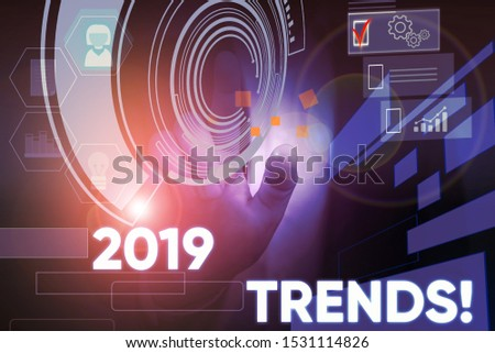 Conceptual hand writing showing 2019 Trends. Business photo text general direction in which something is developing or changing Male wear formal suit presenting presentation smart device.