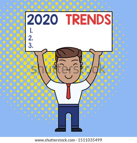 Conceptual hand writing showing 2020 Trends. Business photo text things that is famous for short period of time in current year Smily Man Standing Holding Placard Overhead with Both Hands.