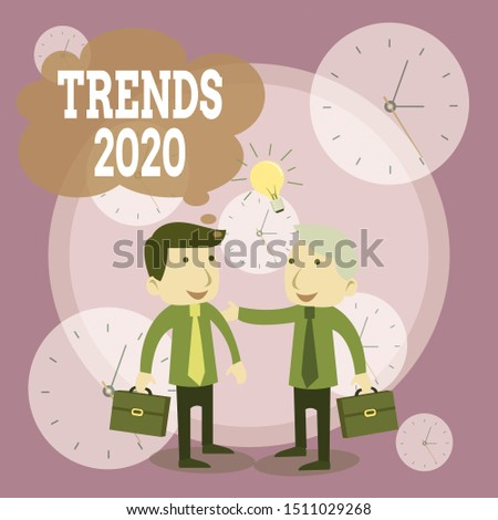 Conceptual hand writing showing Trends 2020. Business photo text Upcoming year prevailing tendency Widely Discussed Online Businessmen Colleagues with Brief Case Sharing Idea Solution.