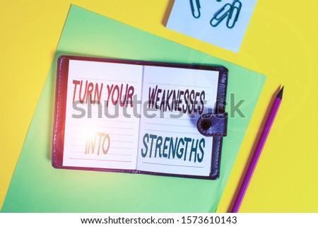 Conceptual hand writing showing Turn Your Weaknesses Into Strengths. Business photo showcasing work on your defects to get raid of them Locked diary striped sheets clips notepad colored background.