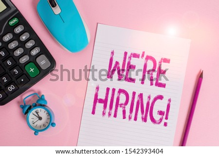 Conceptual hand writing showing We Re Hiring. Business photo text recently employ someone or pay him to do particular job Electronic calculator alarm clock sheet pencil colored background.