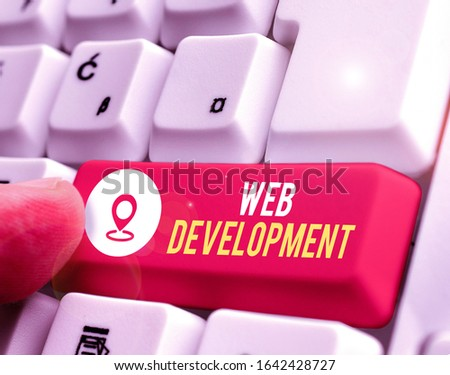 Conceptual hand writing showing Web Development. Business photo showcasing dealing with developing websites for hosting via intranet.
