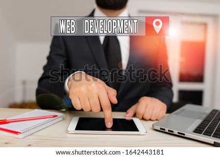 Conceptual hand writing showing Web Development. Business photo text dealing with developing websites for hosting via intranet Male human wear formal clothes present use hitech smartphone.