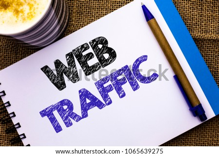 Conceptual hand writing showing Web Traffic. Business photo showcasing Internet Boost Visitors Audience Visits Customers Viewers written on Notebook Book on the jute background Pen and Cup #1065639275