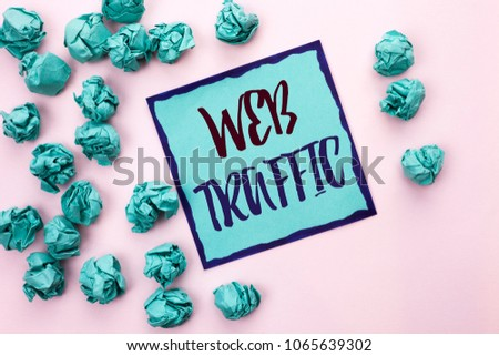 Conceptual hand writing showing Web Traffic. Business photo text Internet Boost Visitors Audience Visits Customers Viewers written on Sticky Note Paper on the light pink plain background. #1065639302