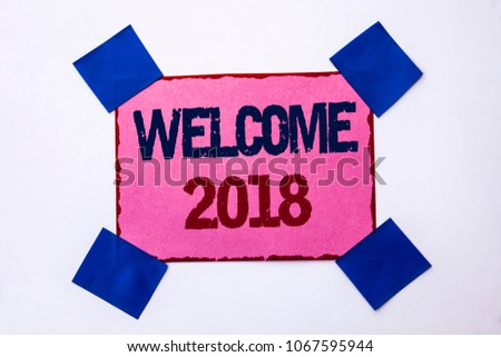 Conceptual hand writing showing Welcome 2018. Business photo text Celebration New Celebrate Future Wishes Gratifying Wish written on Pink Sticky Note Paper on the plain background. #1067595944