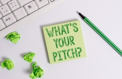 Conceptual hand writing showing What S Is Your Pitch question. Business photo text asking about property of sound or music tone Green note paper with pencil on white background and pc keyboard.