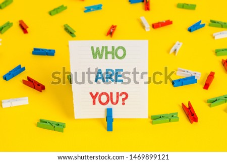 Conceptual hand writing showing Who Are You question. Business photo showcasing asking about demonstrating identity or demonstratingal information.