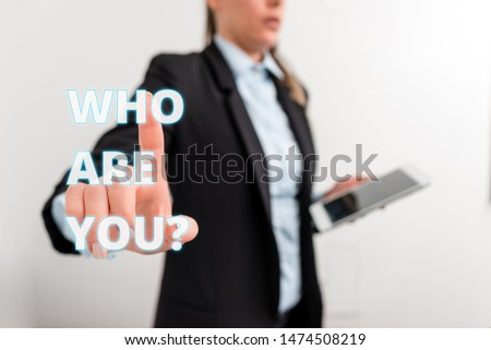 Conceptual hand writing showing Who Are You question. Business photo text asking about demonstrating identity or demonstratingal information Digital business in black suite concept with business woman