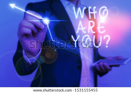 Conceptual hand writing showing Who Are Youquestion. Business photo showcasing someone asking your demonstratingal background or history.