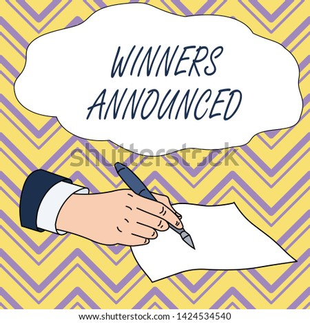 Conceptual hand writing showing Winners Announced. Business photo text Announcing who won the contest or any competition Male Hand Formal Suit Holding Ballpoint Pen Piece of Paper Writing.