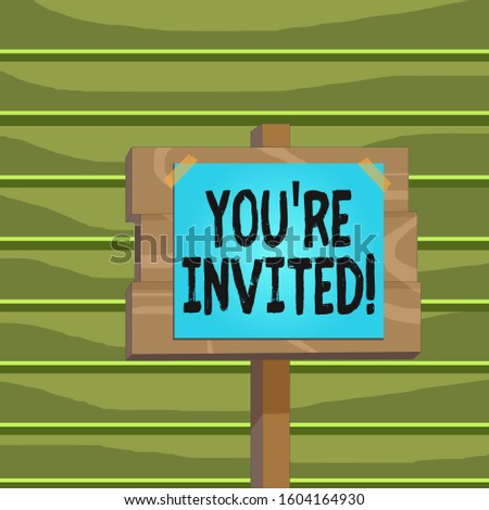 Conceptual hand writing showing You Re Invited. Business photo showcasing make a polite friendly request to someone go somewhere Wood plank wood stick pole paper note attached adhesive tape.