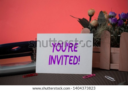 Conceptual hand writing showing You Re Invited. Business photo text make a polite friendly request to someone go somewhere. #1404373823