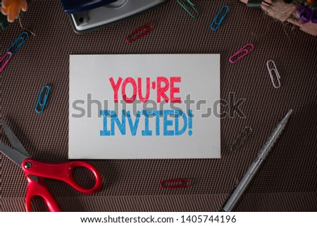 Conceptual hand writing showing You Re Invited. Business photo text make a polite friendly request to someone go somewhere. #1405744196