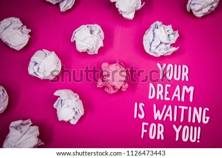 Conceptual hand writing showing Your Dream Is Waiting For You. Business photo text Goal Objective Intention Target Yearning Plan Ideas pink background crumpled papers trial mistakes several tries. #1126473443