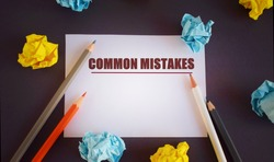 Conceptual hand writing text caption inspiration showing Common Mistakes. Business concept for Common Decision Mistakes written ower white paper, with space.