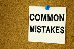 Conceptual hand writing text caption inspiration showing Common Mistakes. Business concept for Common Decision Mistakes written on sticky note, reminder cork background with space