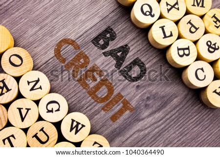 Conceptual hand writing text showing Bad Credit. Concept meaning Poor Bank Rating Score For Loan Finance written wooden abckground with letters