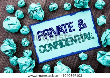 Conceptual hand writing text showing Private And Confidential. Concept meaning Security Secret Sensitive Classified Information written Sticky note paper folded paper the wooden background.