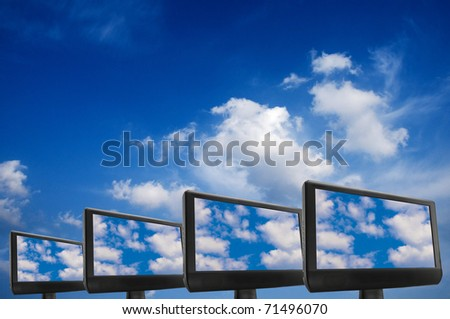 conceptual image for cloud computing, with monitors displaying clouds on screen