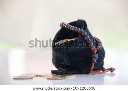 Conceptual image in Islamic finance. coins in pouch with bright background. #1091205530