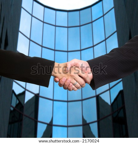 Conceptual image: Man and woman are shaking hands after a business deal.