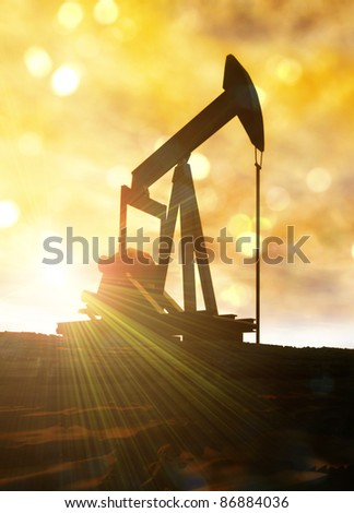 Conceptual image of a land based oil well pump machine with sun flaring from behind it.
