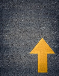 Conceptual Image Of A Painted Yellow Arrow On A Road With Space For Text