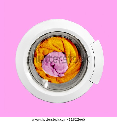 Conceptual image of a washing machine with the color pure towels, isolated on a pink background