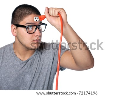 Conceptual image of a young man holding an electrical chord disconnected from the outlet on his forehead.