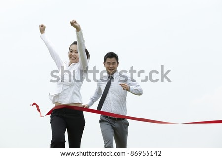 Conceptual image of an Asian Business woman winning a race