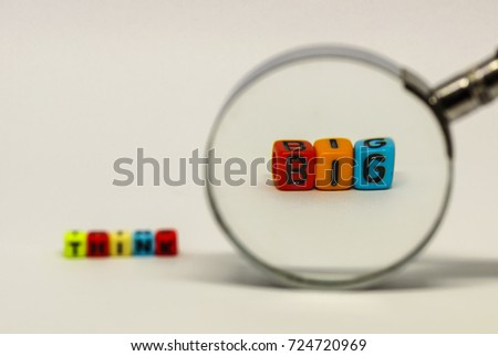 "Conceptual image of ""think BIG"" in business spelled out using generic colorful letter beads. Isolated. White background."