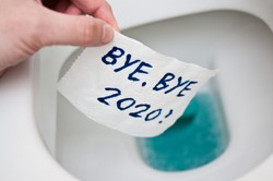 Conceptual image of toilet paper, symbol of covid-19 crisis and pandemia in 2020. Abstract image, saying goodbye to the bad year, leaving the past behind, hoping for better.
