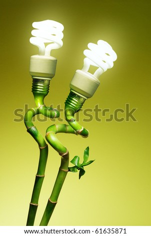 Conceptual image of two economic lamps as flowers on top of green canes - stock photo