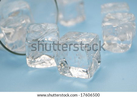 Conceptual image representing dangers of drinking alcohol, excessive drinking, getting drunk: turned over glass with wine leftovers and ice