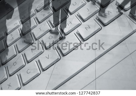 Conceptual image showing shoppers overlaid over laptop keyboard.