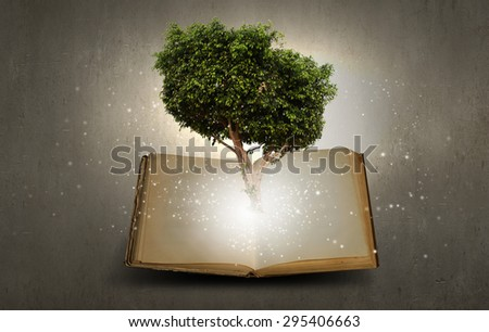 Conceptual image with green tree growing from book