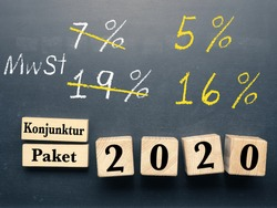 Conceptual image with wooden blocks on a chalkboard with the words economic stimulus package for 2020 in Germany. Temporary VAT reduction in Germany.