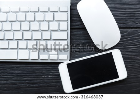 Conceptual Mobile Phone, White Computer Keyboard and Mouse on Table, business concept