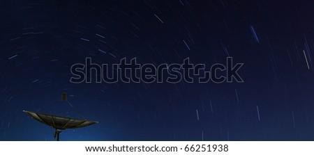 Conceptual of Big Black satellite over spiral star