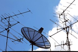 conceptual of satellite and antenna on blue sky